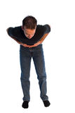 Stomach Pains. Young man isolated on white, with stomach pains Royalty Free Stock Images