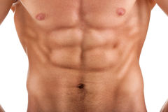 Stomach with a strained muscle bodybuilder Royalty Free Stock Photography