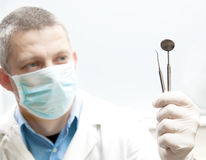 Stomatologic doctor with tools Stock Photos