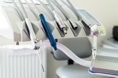 Stomatological instrument in the dentist`s clinic . Stomatological instrument in the dentist`s clinic close up stock photos