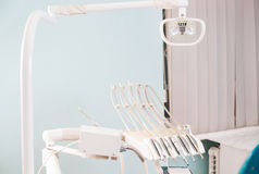 Stomatological instrument in the dentists clinic. Operation, tooth replacement. Stomatological instrument in the dentists clinic. Dental background: work in Stock Photography