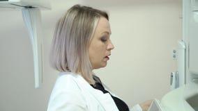 Stomatologiczny radiologiczny przeszukiwacz i pacjent zbiory