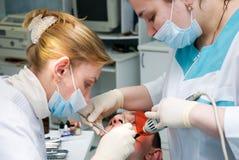 Stomatology. Medical stomatological treatment at the dentist office royalty free stock photos