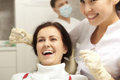 Stomatology concept - dentist with mirror checking patient girl Royalty Free Stock Images