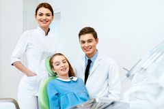 Stomatology. Dentistry Doctors And Patient In Dentist Office stock image