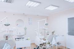 Stomatology interior of dental clinic with professional chair. Dentistry, medicine, medical equipment and stomatology concept. royalty free stock images