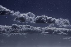 Starry night clouds. Stomg clouds in a starry night royalty free stock photo