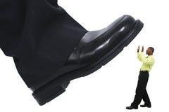 Stomping do piso do pé do homem de negócios para fora a competição fotografia de stock