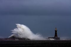 Stomy weather at Roker Lighthouse. Stomy weather and rough seas at Roker Lighthouse Royalty Free Stock Photo