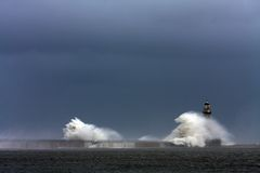 Stomy weather at Roker Lighthouse. Stormy weather and rough seas at Roker Lighthouse Royalty Free Stock Photos