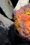 Stone. Colored stone among the gray stones Royalty Free Stock Photo