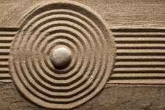 Stone. On raked sand. Mini rock garden. Zen concept Royalty Free Stock Photo
