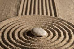 Stone. On raked sand. Mini rock garden. Zen concept Stock Photo