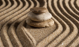 Stone. On raked sand. Mini rock garden. Zen concept Royalty Free Stock Images