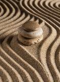 Stone. On raked sand. Mini rock garden. Zen concept Stock Photos