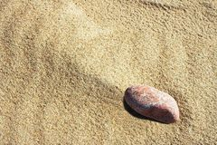 Stone. In sand Royalty Free Stock Image