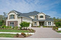 Stone accents new home 12. Newly constructed luxury home with stone accents on front faces Stock Photography