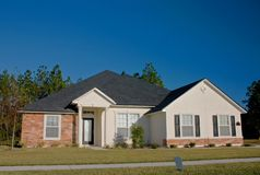 Stone accents new home 3. Newly constructed home with stone accents on exterior areas Stock Photos