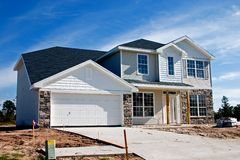 Stone accents new home 4. Newly constructed home with stone accents on front faces Stock Images