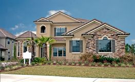 Stone accents new home 9. Newly constructed home with stone accents on faces Royalty Free Stock Photos