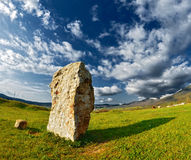 Stone against the beautiful sky with clouds. summer sunset Royalty Free Stock Photography