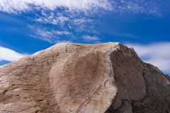 A stone against the blue sky, a stone with a beautiful technical structure royalty free stock photography