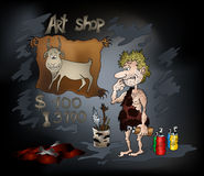 Stone Age Art Shop. The prehistoric artist prepares his first illustration for examination on a photo bank Stock Photo