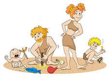 Stone age family making fire Royalty Free Stock Photography