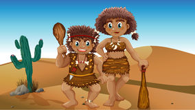 Stone Age people. Stone age couple in the desert Stock Photo