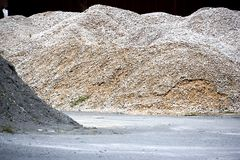 Stone Aggregate. Image of a granite stone aggregate meant for road construction at a rock quarry in Malaysia Stock Image