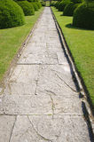Stone alley in English formal garden Stock Photos