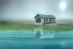 Stone alpine shed at a lake Stock Image