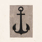 Stone anchor on wall background. Black, grey and white stock photos