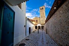 Stone ancient Italian street and church in Cividale del Friuli Stock Image