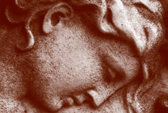 Stone Angel. Close up of a stone carved face of an  angel Stock Images