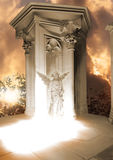 Stone angel appearance. A blessing angel statue is standing on a shining ground, photographed in a church with real sunlight, illuminating it. The temple Royalty Free Stock Image