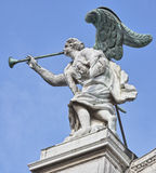 Stone Angel with bronze wings and trumpet Stock Photos