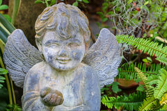 Stone Angel Sculpture decorating the garden Stock Image