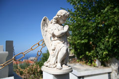 Stone Angel Statue. A stone angel statue in a Greek cemetery with a fly on its wing Royalty Free Stock Photo