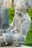Stone angel statue in ancient cemetery II Royalty Free Stock Photography