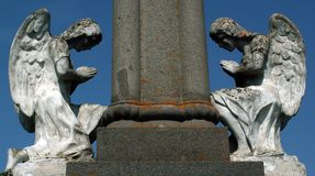 Stone angels. On a world war monument in Transylvania Royalty Free Stock Image