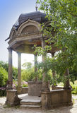 Stone arbor with a bowl with sacred source in the territory of Yuryev Monastery, Great Novgorod, Russia. Royalty Free Stock Photo