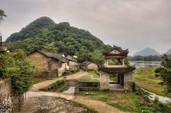 Stone arbor pagoda  at entrance to mountain village, rural China Royalty Free Stock Photo
