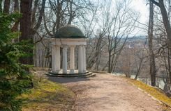 Stone arbor in park, Gorki Lenin Museum-Reserve  in spring, Moscow region, Russia. Old stone arbor in park, Gorki Lenin Museum-Reserve  in spring, Moscow region Royalty Free Stock Photo