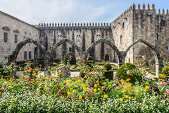 Stone arcada in the flowers garden. Stock Images