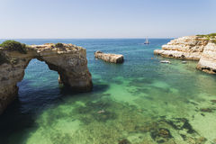 Stone arch of the Albandeira beach. Natural rock arch in the waters of the albandeira Beach in Algarve, Portugal Royalty Free Stock Images