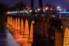 Stone Arch Bridge. The Beautiful Stone Arch Bridge at Night in Minneapolis Minnesota Stock Images