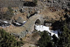 Stone arch bridge across river Royalty Free Stock Photo