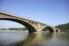 Stone arch bridge and blue color sky Royalty Free Stock Photography