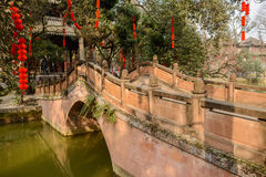 Stone arch bridge in Chinese traditional style on sunny day Royalty Free Stock Image